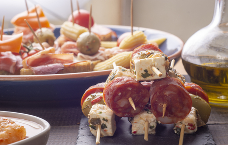 Snacks on skewers with cheese and sausage. Ready for eat. New Year's Eve Banco de Imagens