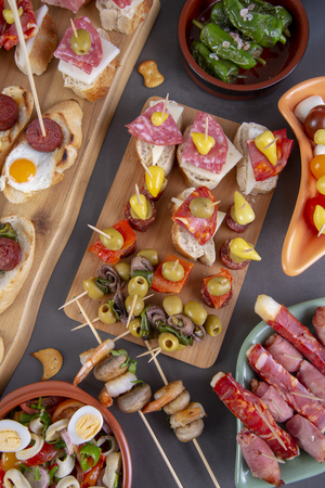 Top view of table with variety of mediterranean appetizers - tapas food. View from above