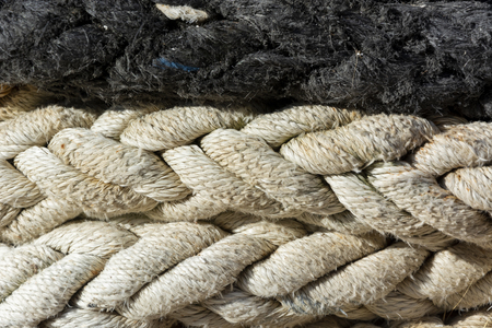 Close-up of old damaged mooring ropes for background or texture 免版税图像