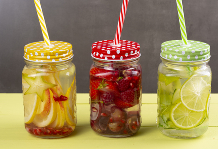 Fresh cold water with lemon, lime and carambola and strawberries and raspberries