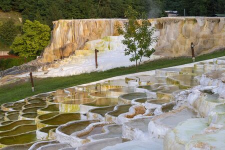 Famous travertine limestone rock formations of thermal waters in Egerszalok, Hungary Banco de Imagens - 130894224