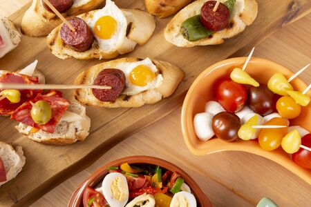 Top view of a variety of snacks - spanish tapas or italian antipasti. Flat lay