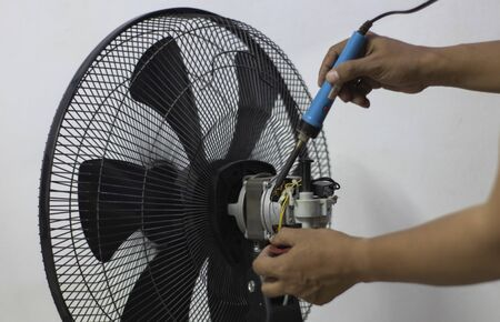Close-up motor fan Repair and maintenance of home appliances for fixing the fan,  nut and wire copper roll of motor fan on black background