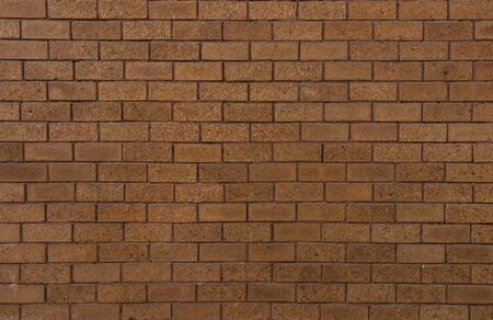bricks red and brown color arranged in rows on wall, for texture and design work background.