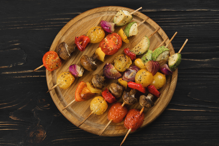 mediterranian: Top view of vegetable skewers on a wooden background. Stock Photo