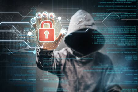 Male hacker accessing to personal information. Hooded man with obscure face touching digital panel with mixed media and binary code. Technologal, virtual crime, cybersecurity concept.