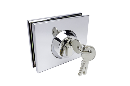 Isolated metal door lock with keys on white background