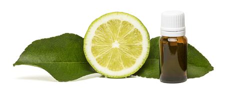 Lemon essential oil with a half lemon fruit and two leaves isolated on white background 版權商用圖片
