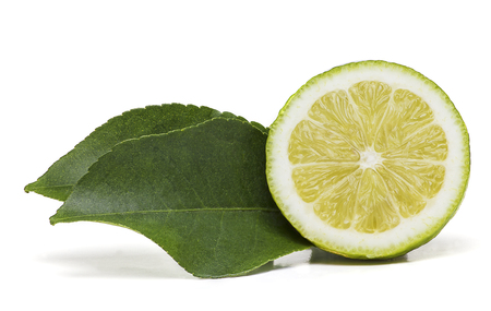 Half lemon fruit with two green leaves on the side isolated on with background