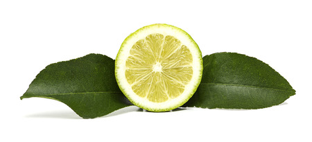 Half lemon fruit with two green leaves isolated on with background