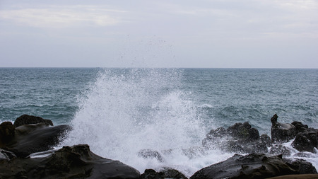 rare rocks: Waves hit the rock with water splash  Stock Photo