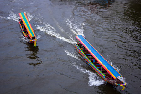 motorboats: Two motorboats racing on the rivers of Chao Phraya Thailand