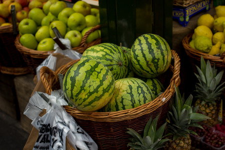 grocers: Watermelons on sale at fruit stand