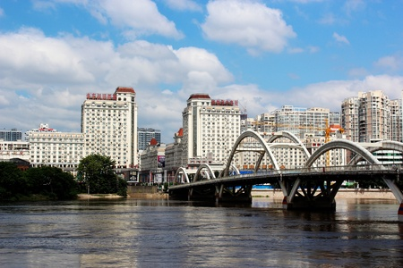 the liberation bridge across the Ming river  and riverside buildings