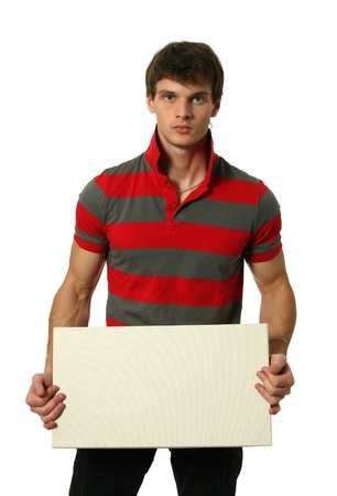 Young sexy man holding copy space blank board isolated on white Stock Photo