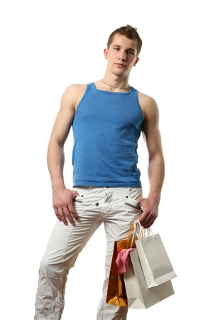 Young muscular sexy man with copy space shopping bags isolated on white photo