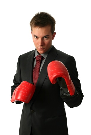 Young businessman wearing boxing-gloves isolated on white Stock Photo - 15392491