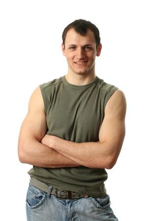 muscle shirt: Hombre joven sexy con una camisa verde musculares aisladas en blanco