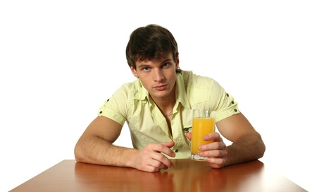 Young sexy man drinking orange juice isolated on white photo