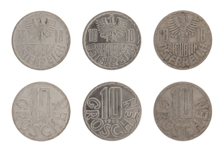 Old Austrian ten groschen coins isolated on white photo