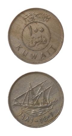 Kuwaiti 100 fils coin isolated on white photo