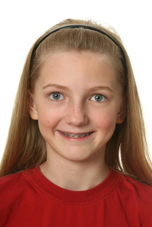 cute braces: Young girl with dental braces on her teeth isolated on white Stock Photo