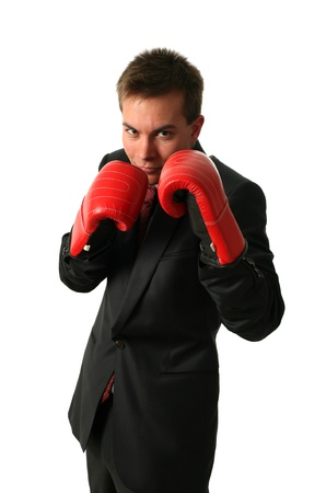 Young businessman wearing boxing-gloves isolated on white Stock Photo - 15400511