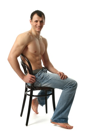 pecs: Young muscular man sitting on the chair isolated on white Stock Photo