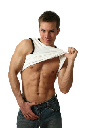 six pack: Young muscular man showing his abs isolated on white Stock Photo