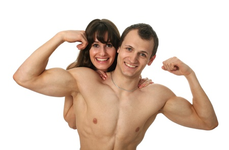 Young woman embracing her muscular boyfriend with flexing biceps isolated on white