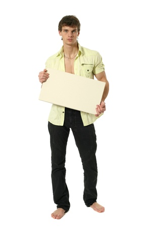 undone: Young sexy man holding copy space blank sign isolated on white