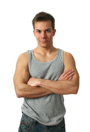 Young muscular man wearing a gray sleeveless shirt isolated on white photo