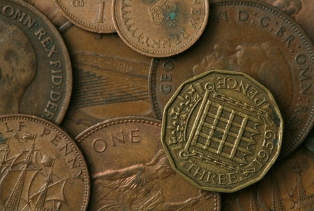 european: Old coins of the United Kingdom Texture Stock Photo