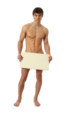 hombre desnudo: Hombre desnudo musculares que cubre con una placa de espacio de la copia en blanco aislado en blanco