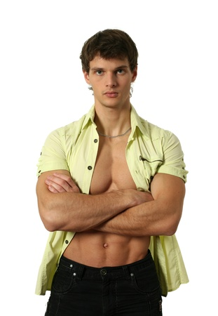 shirt unbuttoned: Young muscular man in undone shirt isolated on white