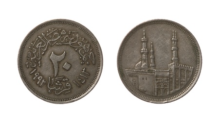 an obverse: Twenty Egyptian qirsh or piastres coin from 1992 year. Obverse and reverse isolated on white.