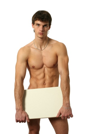 naked abs: Nude muscular man covering with a copy space blank board isolated on white