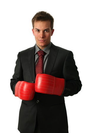 Young businessman wearing boxing-gloves isolated on white Stock Photo - 15450776