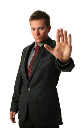 Warning businessmen holding his palm up isolated on white. Face in focus photo