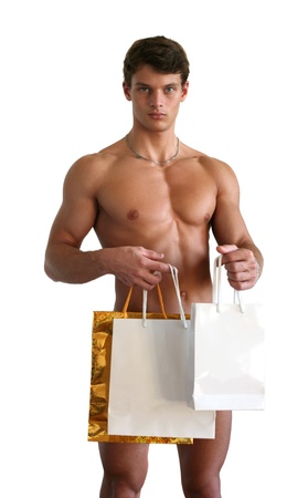 Young sexy man with copy space shopping bags isolated on white Stock Photo - 15483962
