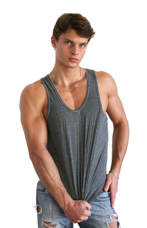 torso only: Young muscular man wearing a sleeveless shirt isolated on white