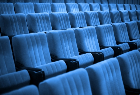 Empty chairs at cinema or theatre  Blue Tone photo