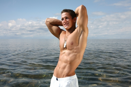 Muscular young man on the beach Stock Photo - 15484033
