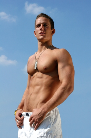 Muscular male torso with army tags on the blue sky Stock Photo - 15481217