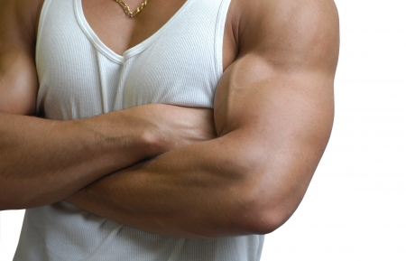 Muscular male torso in a white sleeveless shirt isolated on white Stock Photo - 15483982