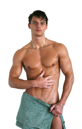 Wet muscular man wrapped in a towel isolated on white
