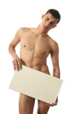 desnudo masculino: Un hombre desnudo muscular, cubriendo con un signo copia espacio en blanco aislado en blanco