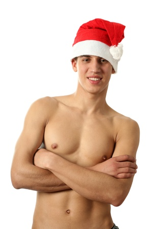 torso only: Sexy muscular shirtless man in Santa Claus hat isolated on white