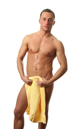 Wet muscular man covering with a towel isolated on white