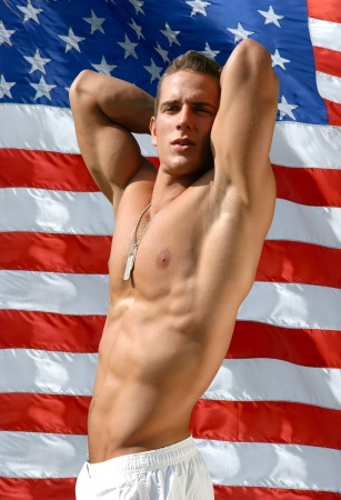 Muscular sexy man with army tags with US flag behind Stock Photo - 15540226